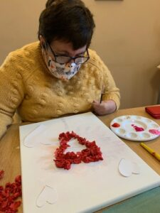 image of customer with heart craft activity